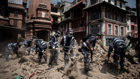 Members of the Nepalese police clear debris from Durbar Square in Kathmandu on Sunday, May 3.