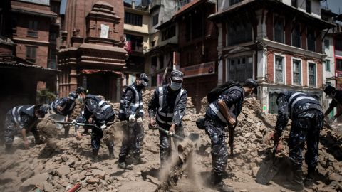 """Nepalese police officers clear debris from Durbar Square in Kathmandu on Sunday, May 3. A magnitude-7.8 earthquake centered less than 50 miles from Kathmandu <a href=""""http://www.cnn.com/2015/04/28/asia/nepal-earthquake/index.html"""">rocked Nepal with devastating force</a> Saturday, April 25. The earthquake and its aftershocks have turned one of the world's most scenic regions into a panorama of devastation, killing and injuring thousands."""