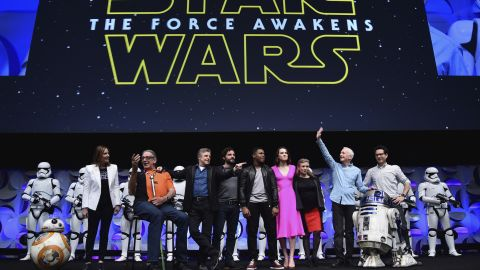 """""""The Force Awakens"""" cast, along with droids, executive producer Kathleen Kennedy and director J.J. Abrams, appeared at the Star Wars Celebration fan convention in April."""