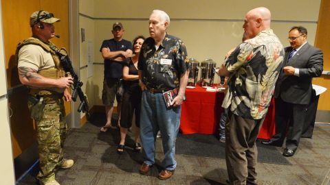 A member of the Garland police department keeps members of the audience inside the Curtis Culwell Center in Garland, Texas, after reports of shots fired outside. A Dutch member of parliament and leader of the far-right Party for Freedom, Geert Wilders delivered the keynote address at the Muhammad Art Exhibit and Contest. The art exhibit is being put on by the Pamela Geller's American Freedom Defense Initiative.
