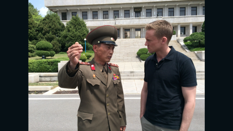 """Junior Lt. Col. Nam Dong Ho speaks to CNN correspondent Will Ripley. In May 2015, Ripley and his team were <a href=""""http://www.cnn.com/2015/05/02/asia/cnn-inside-north-korea/"""">granted rare access to the Demilitarized Zone (DMZ) in North Korea.</a> An estimated three-quarters of North Korea's standing army of more than a million is based near the heavily fortified border."""