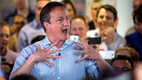 HENDON, ENGLAND - MAY 05: Prime Minister David Cameron speaks to staff at Utility Warehouse on May 5, 2015 in Hendon, England. Campaigning has intensified in the last few days before voters go to the polls in a general election on May 7, 2015. (Photo by Rob Stothard/Getty Images)