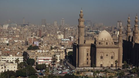 The Sultan Hassan Mosque and city skyline of Cairo are seen from the Muhammad Ali Mosque in Cairo's Citadel on October 21, 2013, in Cairo, Egypt.