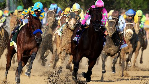 American Pharoah #18, ridden by Victor Espinoza, races Firing Line #10, ridden by Gary Stevens, out of turn 4 during the 141st running of the Kentucky Derby at Churchill Downs on May 2, 2015 in Louisville, Kentucky. (Photo by Andy Lyons/Getty Images)