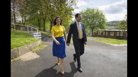 Nick Clegg, leader of the Liberal Democrats, and his wife, Miriam Gonzalez Durantez, arrive to vote at the Hall Park Centre in Sheffield, South Yorkshire, England.