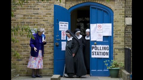 Nuns leave a polling station after voting in London on May 7.