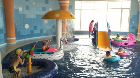 The orphanage features a pool area for the children, who live and study in the complex.