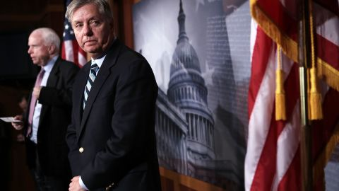 McCain, left, and Graham speak during a news conference about Benghazi on February 14, 2013, on Capitol Hill.