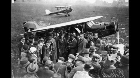Amelia Earhart is surrounded by a crowd of well-wishers and reporters on arrival at Hanworth Air Park in England after crossing the Atlantic in 1932.