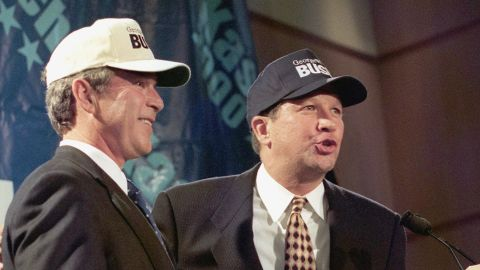 """Kasich, right, then a member of the U.S. House, sports """"Bush"""" baseball caps with Texas Gov. George W. Bush on July 14, 1999. The two lawmakers held a news conference at the Ronald Reagan International Trade Center in Washington during Bush's presidential run. Kasich had previously announced that he was withdrawing from the 2000 presidential race and endorsed Bush."""