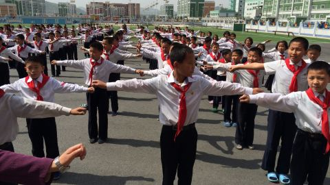 Outdoor exercise accompanied by upbeat music is a daily routine for these North Korean middle school students. Classes are critiqued on their coordination.