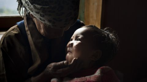 The mother of Dawa Chiri Sherpa cares for his 18-month-old daughter after the climbing guide was killed by a quake-triggered avalanche at Everest Base Camp.