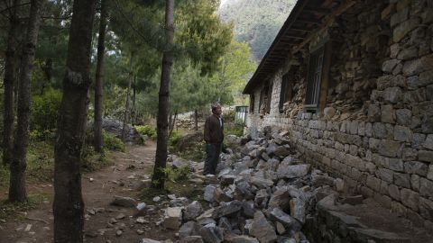 Principal Biruman Rai surveys the damage at his school in Chaurikharka. He says it will take at least three moths before the classrooms can hold children again.