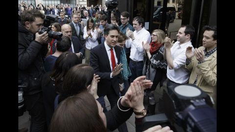"""Labour Party leader Ed Miliband arrives with his wife Justine at the Labour Party headquarters in London on May 8. Miliband retained his seat during the election but said it was a """"clearly disappointing night."""""""