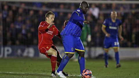 """English footballer Adebayo Akinfenwa is known as """"The Beast"""" due to his imposing 105 kg (231 lbs) bulk. He plays in the lower leagues, now at AFC Wimbledon, and scored against top-flight team Liverpool in an FA Cup third-round match on January 5, 2015."""