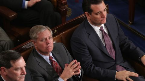 Graham and U.S. Sen. Ted Cruz, R-Texas, right, listen as President Barack Obama delivers the State of the Union address on January 28, 2014. Graham was in the U.S. Air Force and logged six-and-a-half years of service on active duty as an Air Force lawyer.