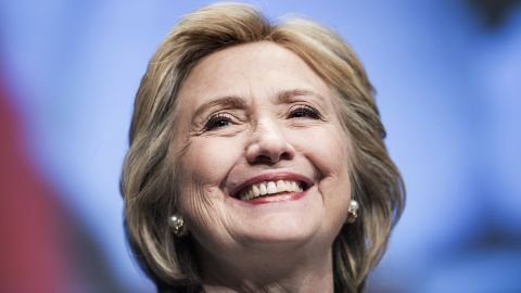 Former Secretary of State Hillary Clinton smiles before speaking at the World Bank May 14, 2014 in Washington, DC. Clinton and World Bank President Jim Yong Kim joined others to speak about women's rights.