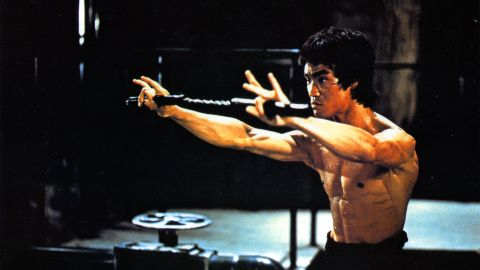 """Martial-arts actor Bruce Lee, seen here training in a scene from the film """"Enter the Dragon,"""" dies in July 1973 just days before the movie's release. He was 32. The film would cement Lee's legend and bring martial arts to the forefront of pop culture."""