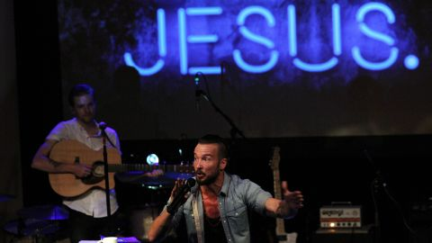 - In this July 14, 2013 photo, Pastor Carl Lentz leads a Hillsong NYC Church service at Irving Plaza in New York. With his half-shaved head, jeans and tattoos, Lentz doesn't look like the typical religious leader. But with its concert-like atmosphere and appeal to a younger demographic, his congregation, Hillsong NYC, is one of the fastest growing evangelical churches in the city. (AP Photo/Tina Fineberg)