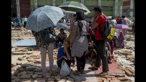 People gather in an open space in Kathmandu on May 12.