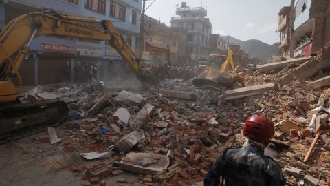 Debris is cleared from the site of a collapsed building in Kathmandu on May 12.