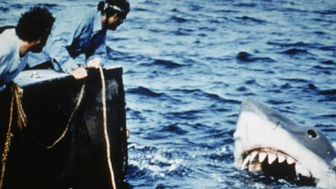 """In the summer of 1975, Steven Spielberg had people flocking to the theaters instead of the beaches. The success of """"<a href=""""https://www.cnn.com/2015/06/05/entertainment/jaws-movie-40th-anniversary-feat/index.html"""" target=""""_blank"""">Jaws</a>"""" -- his first hit movie -- set up summer as the season for Hollywood's biggest and highest-grossing movies."""