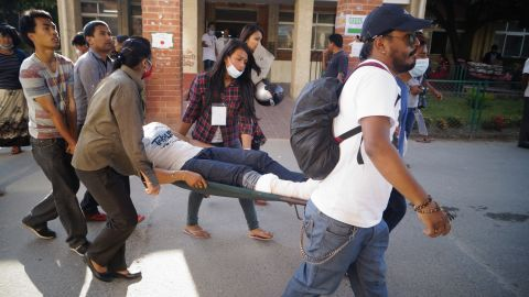 An injured person is carried in Kathmandu on May 12.