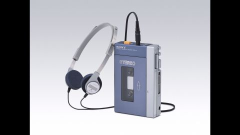 """The sound barrier is broken once again in the '70s, but this time at walking speed. Sony introduces the Walkman, the first commercially successful """"personal stereo."""" Its wearable design and lightweight headphones gave listeners the freedom to listen to music privately while out in public. The product was an instant hit. The Walkman was a mark of coolness among consumers, setting a standard for future generations of personal devices like the Apple iPod."""