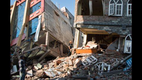 People look through the debris of buildings in Kathmandu on May 12.