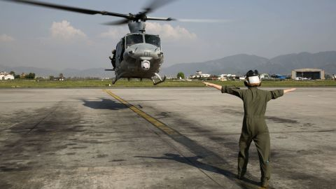 Cpl. Mackenzie Higgins guides a UH-1Y Huey for takeoff at the Tribhuvan International Airport in Kathmandu, Nepal, May 5.