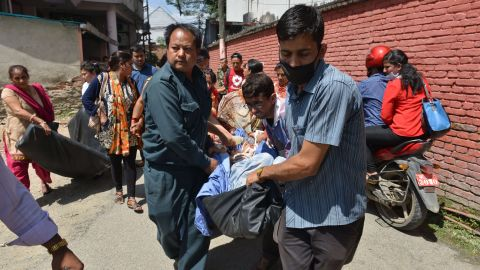 Nepalese patients are carried out of a hospital building as a 7.4 magnitude earthquake hits the country, in Kathmandu on May 12, 2015. A 7.4-magnitude earthquake hit devastated Nepal, sending terrified residents running into the streets in the capital Kathmandu, according to witnesses and the US Geological Survey. The quake struck at 12:35pm local time in the Himalayan nation some 83 kilometres (52 miles) east of Kathmandu, more than two weeks after a 7.8-magnitude quake which killed more than 8,000 people. AFP PHOTO / PRAKASH MATHEMA (Photo credit should read PRAKASH MATHEMA/AFP/Getty Images)