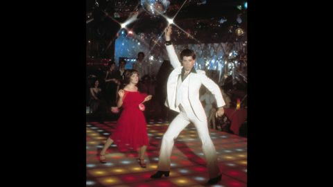 """Disco music sweeps the nation with the 1977 film """"Saturday Night Fever"""" starring John Travolta. Catapulted by a soundtrack containing five No. 1 singles -- including """"Staying Alive"""" and """"Night Fever"""" -- the film became a huge commercial success. The soundtrack stayed on top of the album charts for six months, and Travolta earned an Academy Award nomination for Best Actor."""