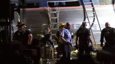 Emergency workers search for the injured on the night of the crash.