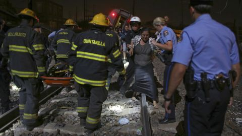 Passengers are helped away from the scene of the crash on May 12.