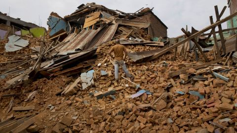 A man looks at massive damage in Chautara, Nepal, on Wednesday, May 13.