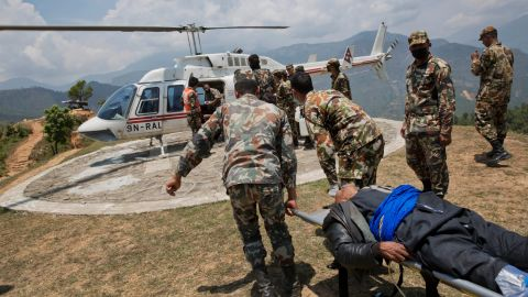 A helicopter waits to evacuate an injured man at a Nepali army base near Chautara on May 13.