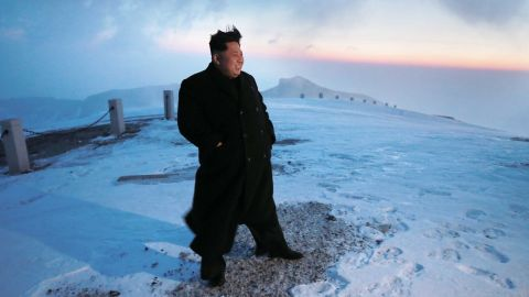 Kim stands on the snow-covered top of Mount Paektu in North Korea in a photo taken by North Korean newspaper Rodong Sinmun on April 18 and released the next day by South Korean news agency Yonhap. Kim scaled the country's highest mountain, North Korean state-run media reported, arriving at the summit to tell soldiers that the hike provides mental energy more powerful than nuclear weapons.