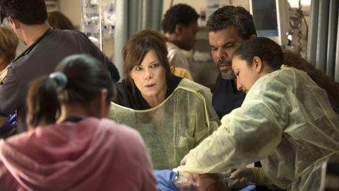 "Marcia Gay Harden and Luis Guzman, center, star in CBS' new medical drama ""Code Black."""