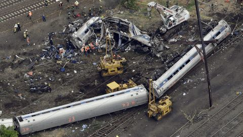 Emergency personnel work at the scene of a deadly train derailment in Philadelphia on Wednesday, May 13. An Amtrak train headed from Washington to New York City crashed Tuesday night in Philadelphia. Eight people were killed and more than 200 were injured.