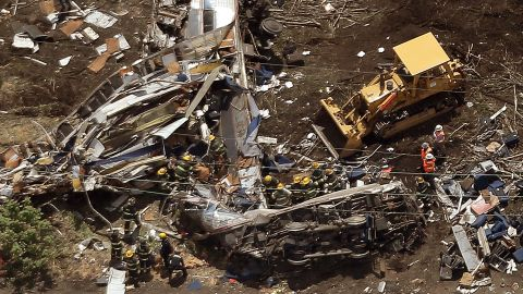 PHILADELPHIA, PA - MAY 13: Investigators and first responders work near the wreckage of Amtrak Northeast Regional Train 188, from Washington to New York, that derailed yesterday May 13, 2015 in north Philadelphia, Pennsylvania. At least six people were killed and more than 200 others were injured in the crash. (Photo by Win McNamee/Getty Images)