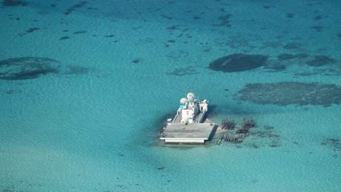 This handout photo taken on February 28, 2013 and received from the Philippine Department of Foreign Affairs (DFA) on April 13, 2015 shows an aerial shot of a structure after a large-scale reclamation by China on the Chinese-held Johnson South Reef -- also claimed by the Philippines and Vietnam -- in what is part of the disputed Spratly chain. The Philippines released photographs on May 15, 2014 to back its claim that China was reclaiming land on the disputed reef, known as Mabini Reef in the Philippines, in the South China Sea in an apparent effort to build an airstrip. Beijing reaffirmed its right to build on disputed islands in the South China Sea on April 9, 2015 after new satellite imagery emerged of construction operations further south in the Spratly islands at Mischief Reef, turning tropical reefs into concrete artificial islands. The Philippines, Vietnam, Malaysia, Brunei and Taiwan all have overlapping claims in the area. AFP PHOTO / Philippine Department of Foreign Affairs