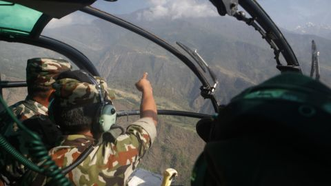 """Members of the Nepalese Army search for a U.S. Marine helicopter in Nepal's Dolakha District on Thursday, May 14. The chopper went missing with six U.S. Marines and two Nepali service members on board.<a href=""""http://www.cnn.com/2015/05/15/asia/us-helicopter-found-nepal/index.html""""> Three bodies were found in the helicopter's wreckage</a> on Friday, Nepal's defense secretary said."""