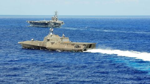 The littoral combat ship USS Independence (LCS 2) conducts maneuvers with the aircraft carrier USS Ronald Reagan (CVN 76) during Rim of the Pacific (RIMPAC) Exercise 2014.