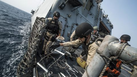 Chief Gunner's Mate Nicholas Bokan, assigned to Surface Warfare Mission Package, Detachment 1, embarked aboard the littoral combat ship USS Fort Worth (LCS 3), rigs a caving ladder on the flight deck during a visit, board, search, and seizure training drill.