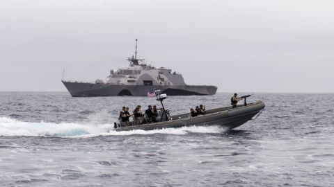 Sailors assigned to Surface Warfare Detachment Four of the littoral combat ship USS Fort Worth (LCS 3) Crew 102 prepare to board a naval training vessel.