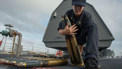 Chief Fire Controlman Beth Simpson-Fuchs moves 57 mm rounds aboard the littoral combat ship USS Fort Worth (LCS 3) while in port at Changi Naval Base Singapore. The 57mm gun is part of the LCS's core ship weapons.
