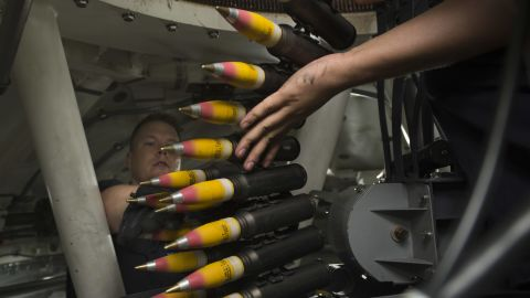 Gunner's Mate 2nd Class Andrew Thomasy and Fire Controlman 1st Class Waylon Clement, assigned to Surface Warfare Detachment 3, load high-explosive incendiary tracer rounds into the ammunition feeder-can of a 30mm weapons system aboard the littoral combat ship USS Fort Worth (LCS 3). The 30mm guns are part of the LCS surface warfare package.