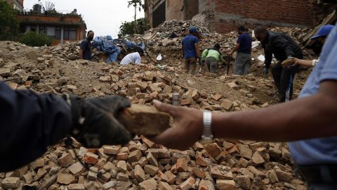 """People collect bricks from the ruins of buildings in Bhaktapur, Nepal, on Friday, May 15. The region was struck with a magnitude-7.3 earthquake on Tuesday, May 12, just 17 days after a <a href=""""http://www.cnn.com/2015/04/25/world/gallery/nepal-earthquake/index.html"""" target=""""_blank"""">magnitude-7.8 quake</a> left thousands dead."""
