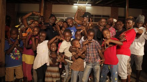 He founded the Breakdance Project Uganda which teaches dance, music and art with education programs that allow poorer kids to go to school.