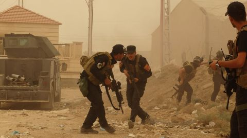 Security forces defend their headquarters against attacks by Islamic State extremists during sand storm in the eastern part of Ramadi, the capital of Anbar province, 115 kilometers (70 miles) west of Baghdad, Iraq, Thursday, May 14, 2015. Islamic State extremists tend to take advantage of bad weather when they attack Iraqi security forces positions, an Iraqi officer said. (AP Photo)